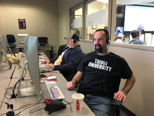 James Kantor sports a volunteer shirt while taking teams' answers at the 40th trivia weekend at St. Cloud State, Feb. 17, 2019.