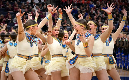 Sartell dancers celebrate as they are announced as state champions Saturday, Feb. 16, following the Minnesota Dance Team High Kick finals at the Target Center in Minneapolis.