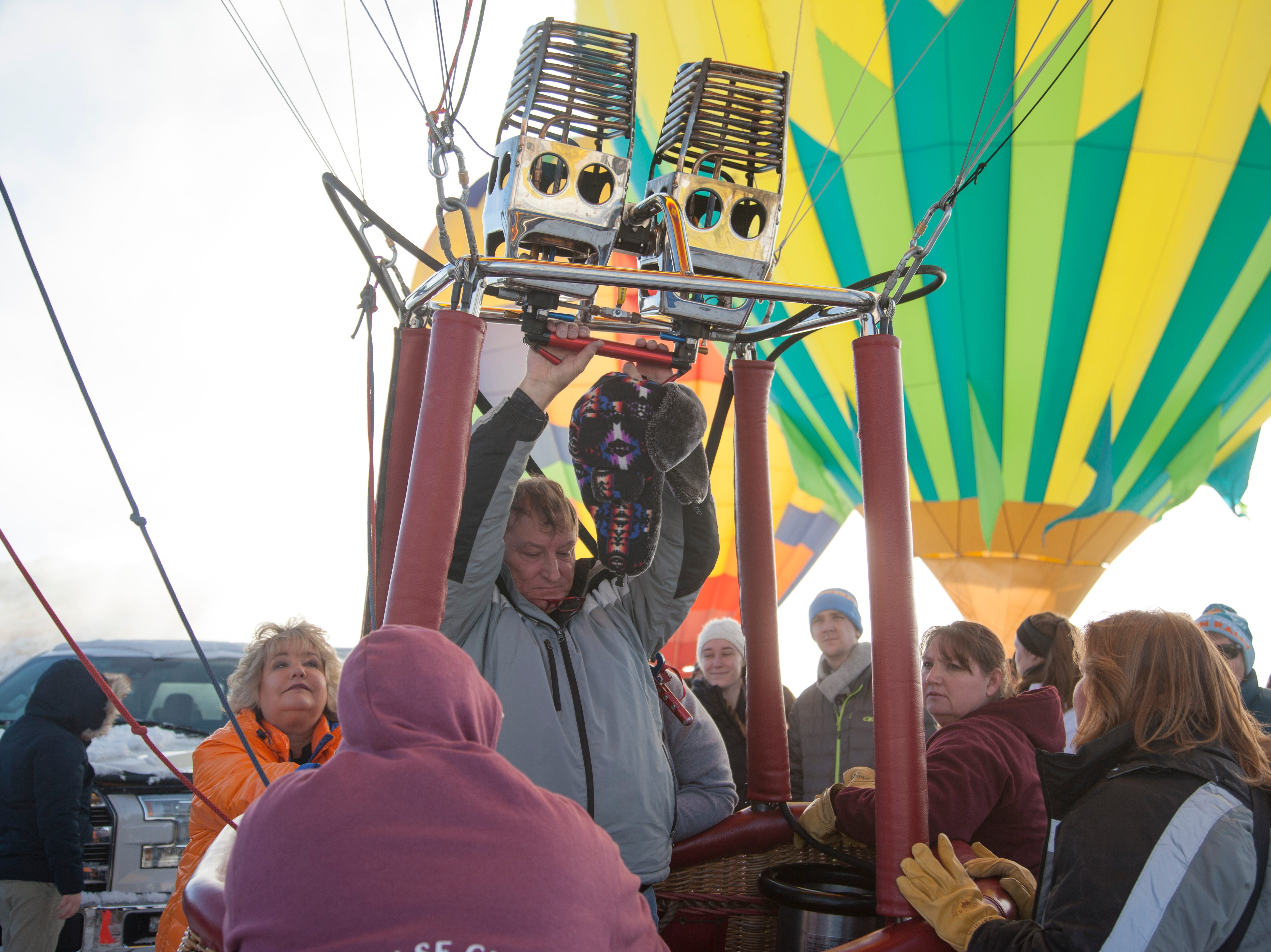Pilots inflate their balloon in Kanab during the Balloons and Tunes festival Saturday, Feb. 16, 2019.