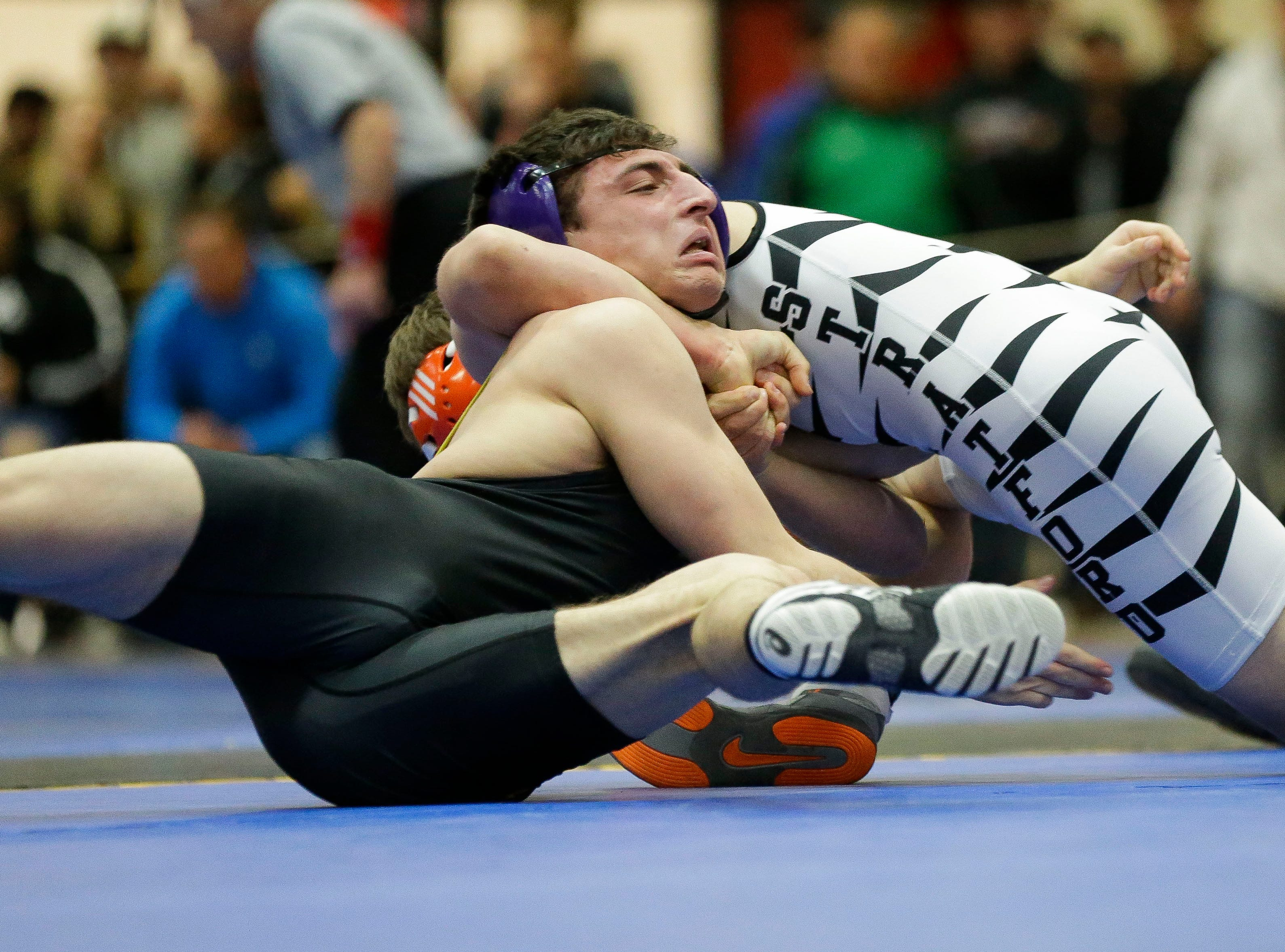 Pittsville's Beau Merritt scrambles against Stratford's Jacob Heiden in a 138-pound championship match on Saturday, February 16, 2019, during a Division 3 sectional meet at Shawano High School in Shawano, Wis.
