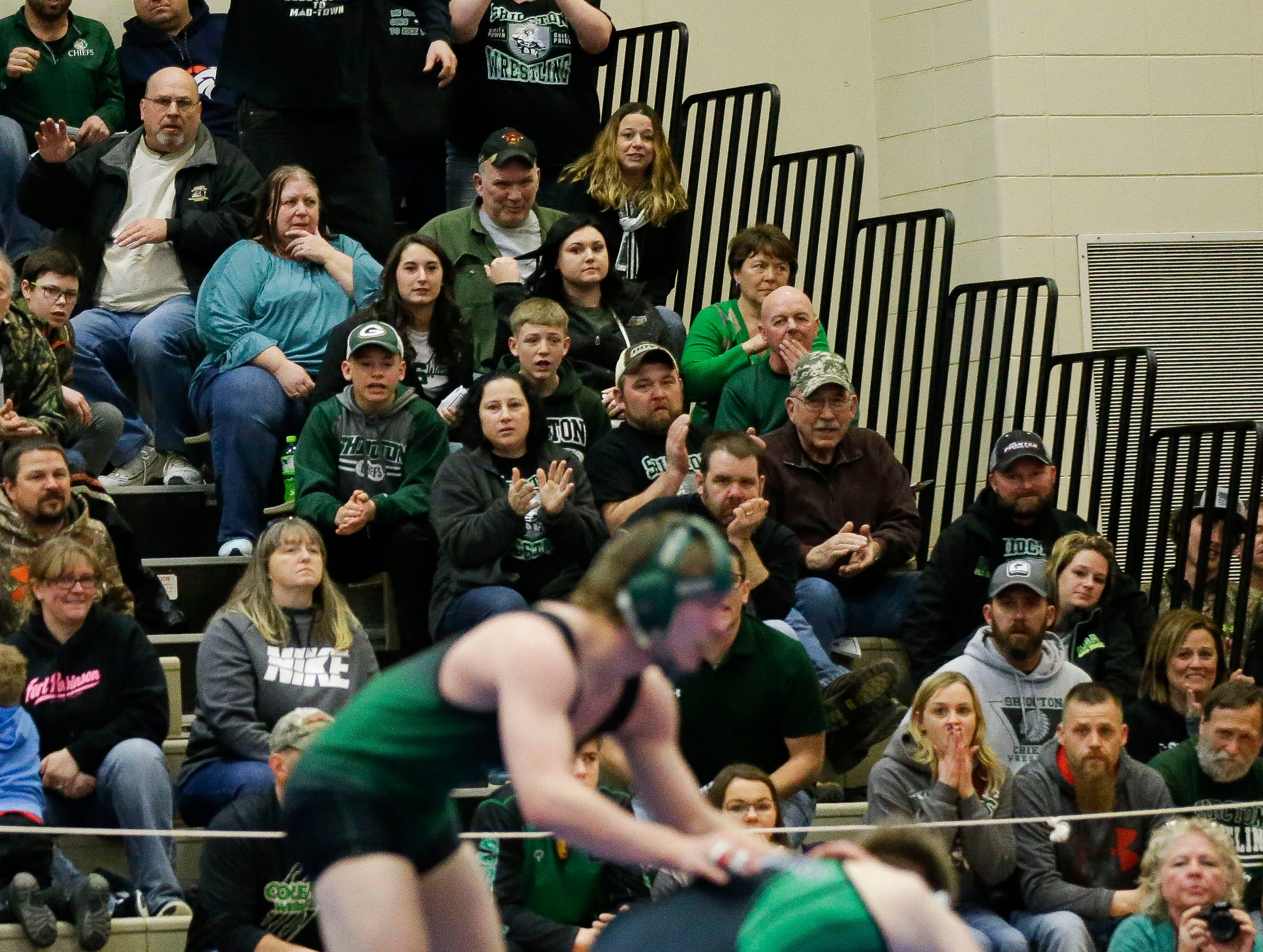 Shiocton fans cheer for Billy Reif in a 160-pound semifinal match on Saturday, February 16, 2019, during a Division 3 sectional meet at Shawano High School in Shawano, Wis.