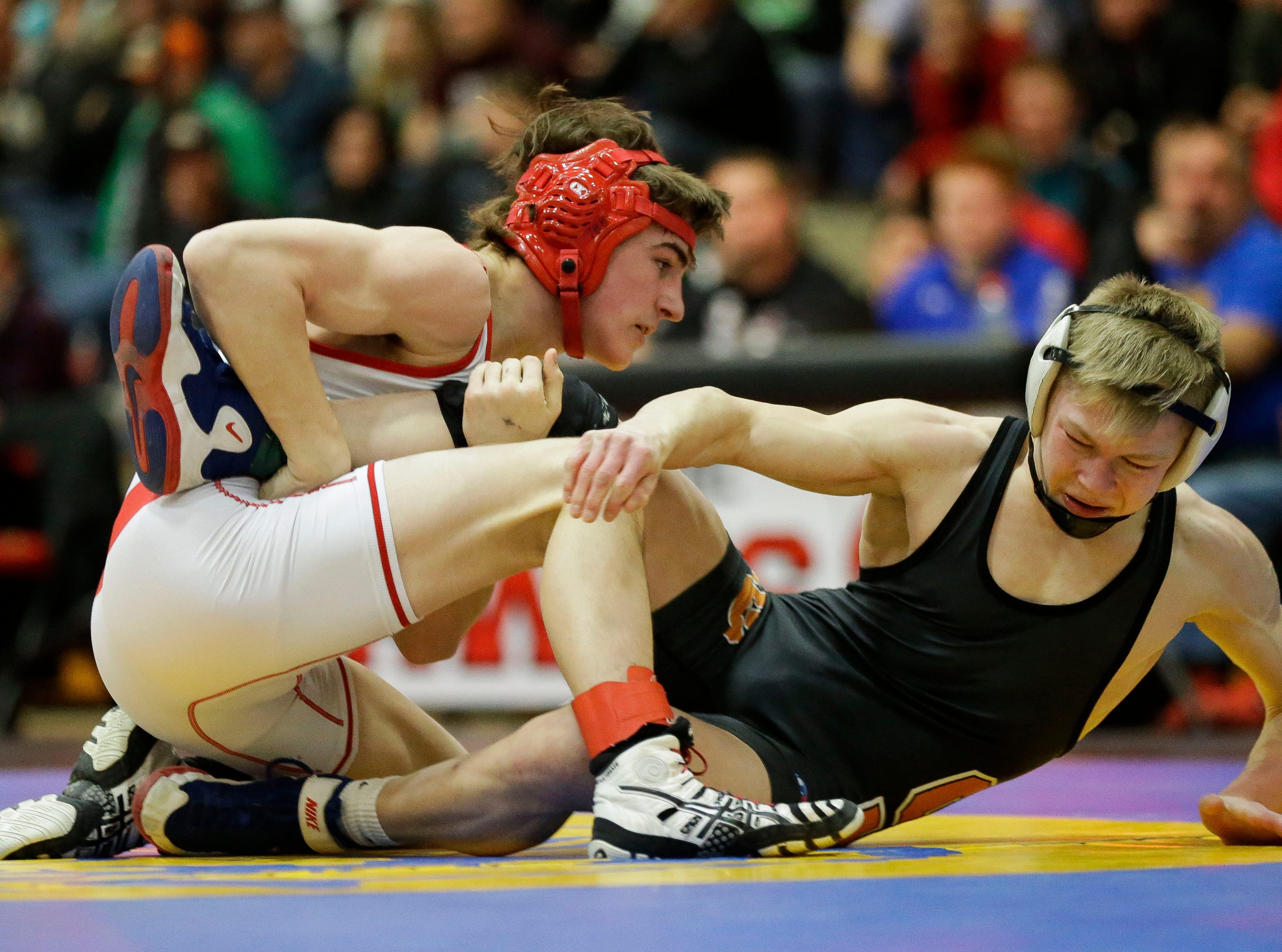 Weyauwega-Fremont's Cian Fischer wrestles against Stratford's Manny Drexler in a 120-pound championship match on Saturday, February 16, 2019, during a Division 3 sectional meet at Shawano High School in Shawano, Wis.
