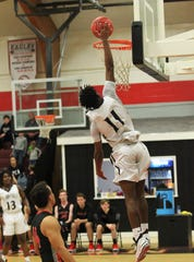 St. John Paul II guard Logan Roberts goes up for a dunk but it rattled out as St. John Paul II's boys basketball team captured a District 1-3A title by beating Pensacola Christian 85-51 at NFC on Feb. 16, 2019.