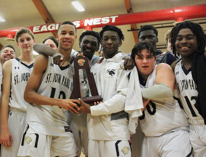 St. John Paul II's boys basketball team captured a District 1-3A title by beating Pensacola Christian 85-51 at NFC on Feb. 16, 2019.