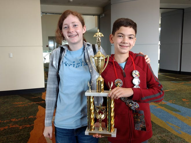 Trinity Catholic School's Jr. Thespian Troupe picked up awards at state festival in Orlando. Grace M. and Joey N. were named best actress and best actor from the 16 one acts presented.