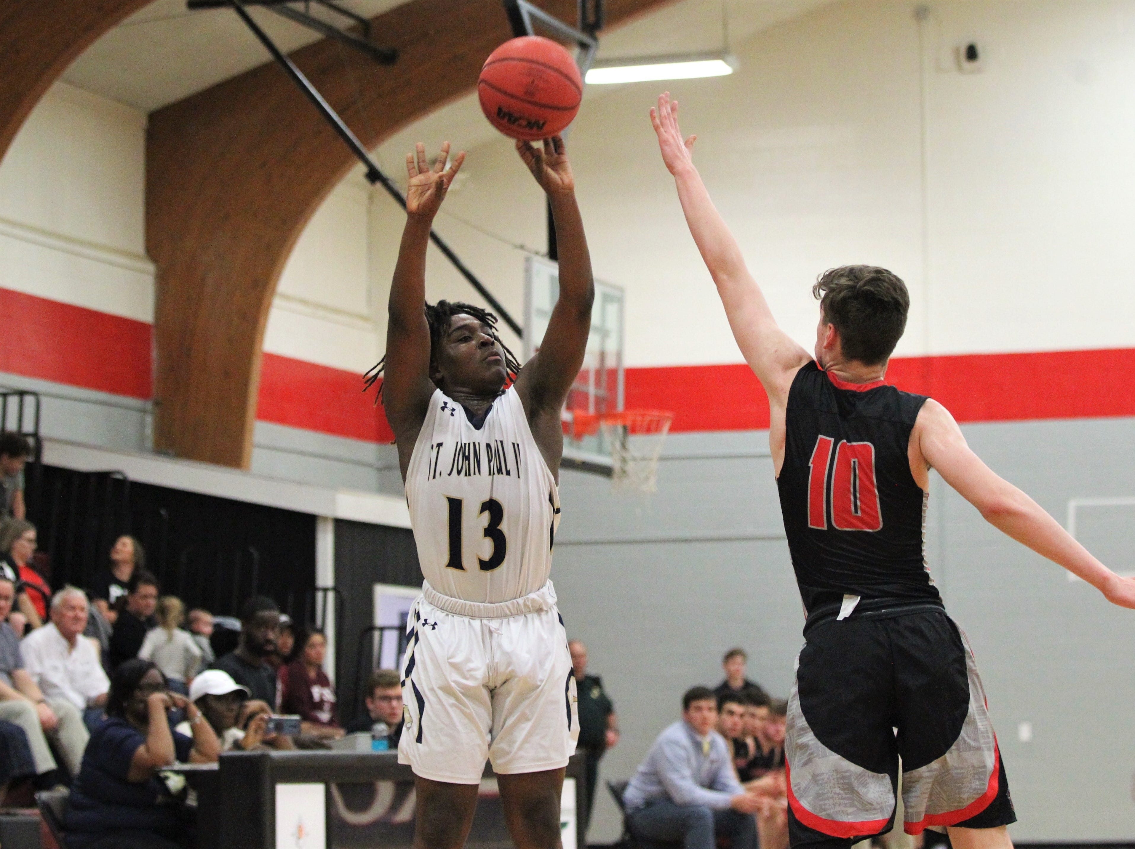 St. John Paul II guard Tyreke McElwain shoots a 3-pointer as St. John Paul II's boys basketball team captured a District 1-3A title by beating Pensacola Christian 85-51 at NFC on Feb. 16, 2019.