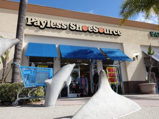 Mike and Irene Gaffney exit the Payless ShoeSource store in Oxnard's Esplanade Shopping Center Sunday, when the chain's liquidation sale began. Some 2,100 stores, including six in Ventura County, will be shuttered in the U.S. and Puerto Rico.
