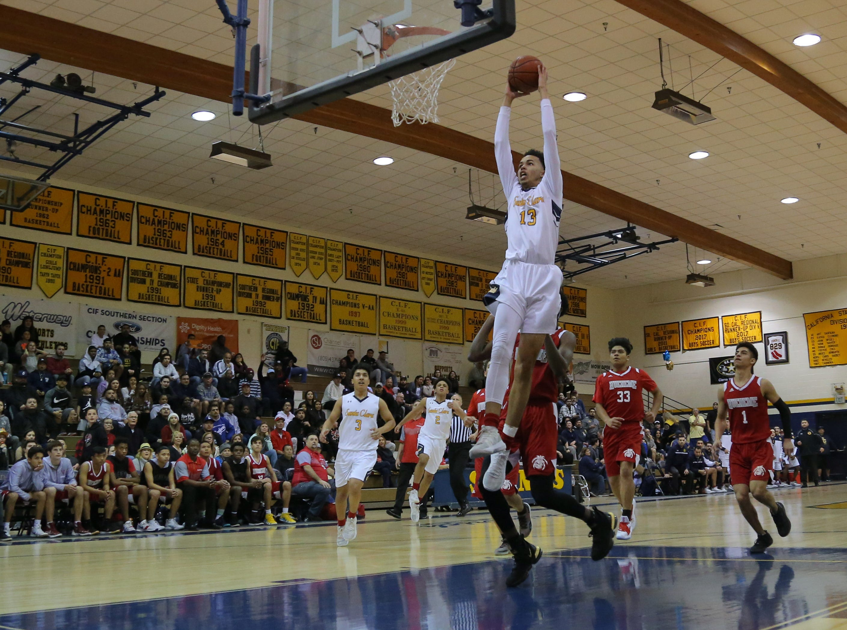Santa Clara's Nick Abbott soars to the basket for a dunk during the Saints' 51-37 victory over Hueneme in Saturday's CIF-Southern Section Division 5AA semifinal at Santa Clara High.