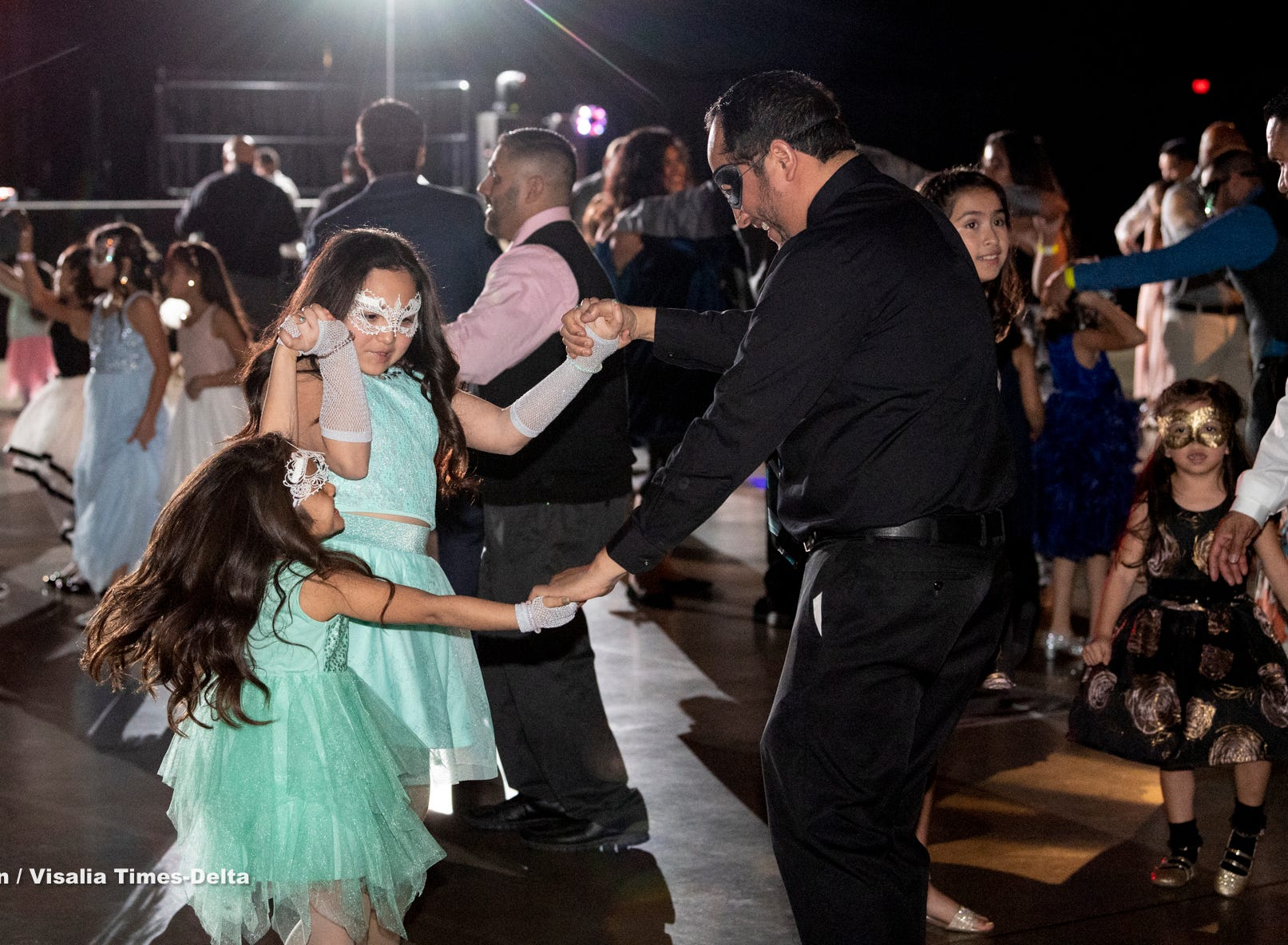 """Girls from 4 to 15 years old and father figures dance during the annual Father-Daughter Dance at the Visalia Convention Center on Saturday, February 16, 2019. This year's theme was """"Masquerade Ball,"""" and included music, dancing and refreshments."""