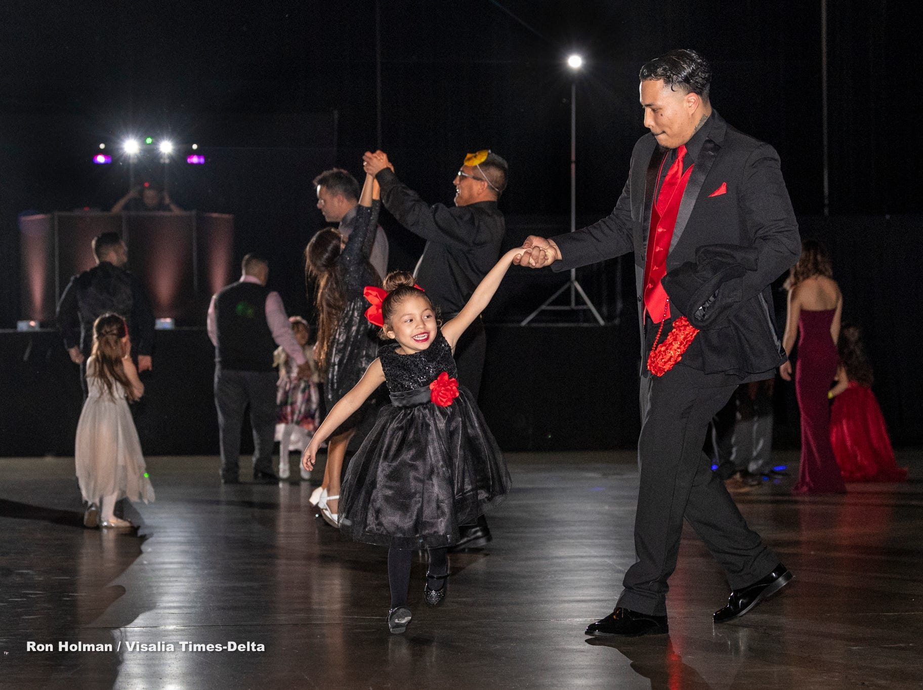 """Samuel Rangel, right, swings his daughter Ariana, 4, during the annual Father-Daughter Dance at the Visalia Convention Center on Saturday, February 16, 2019. This year's theme was """"Masquerade Ball,"""" and included music, dancing and refreshments."""