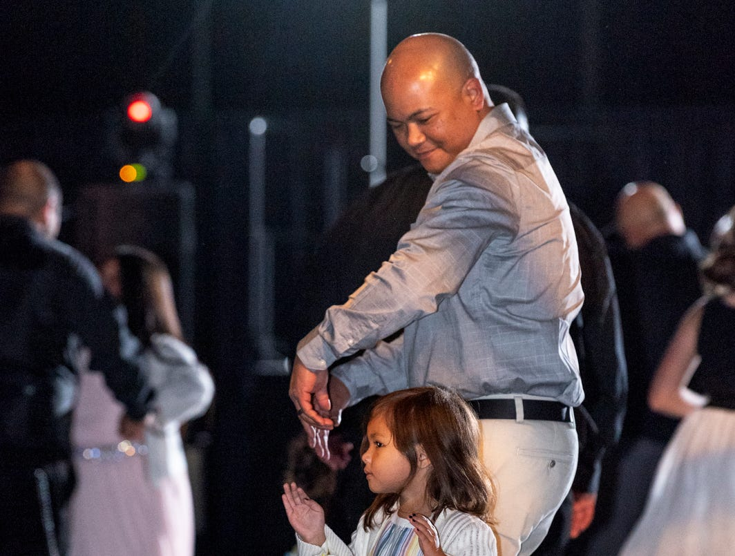 """Rey Quitazol and his daughter Kailee dance as girls from 4 to 15 years old and their father figures dance during the annual Father-Daughter Dance at the Visalia Convention Center on Saturday, February 16, 2019. This year's theme was """"Masquerade Ball,"""" and included music, dancing and refreshments."""