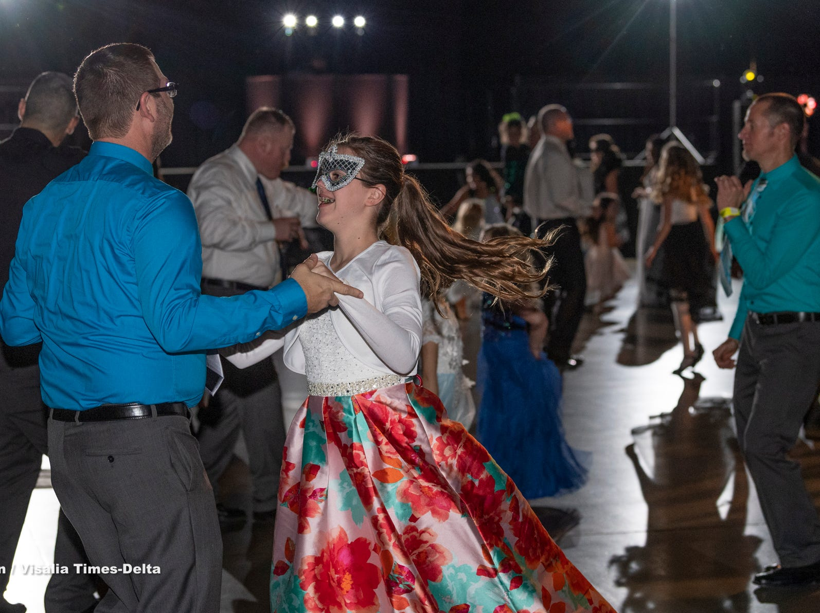 """Reggie Ellis and his daughter Alyssa Ellis, 12, dance during the annual Father-Daughter Dance at the Visalia Convention Center on Saturday, February 16, 2019. This year's theme was """"Masquerade Ball,"""" and included music, dancing and refreshments."""