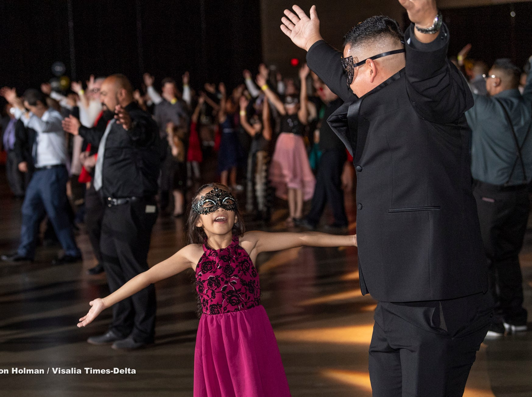 """Angela Jaramoillo, 8, dances with her father Agustin Jaramillo during the annual Father-Daughter Dance at the Visalia Convention Center on Saturday, February 16, 2019. This year's theme was """"Masquerade Ball,"""" and included music, dancing and refreshments."""