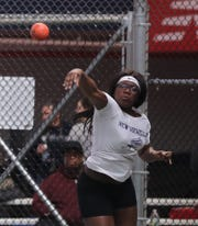 Carrie-Ann Calhoun of New Rochelle competes in the shot put during the Section 1 New York State Track and Field State Qualifier at the New Balance Armory in Manhattan Feb. 17, 2019.