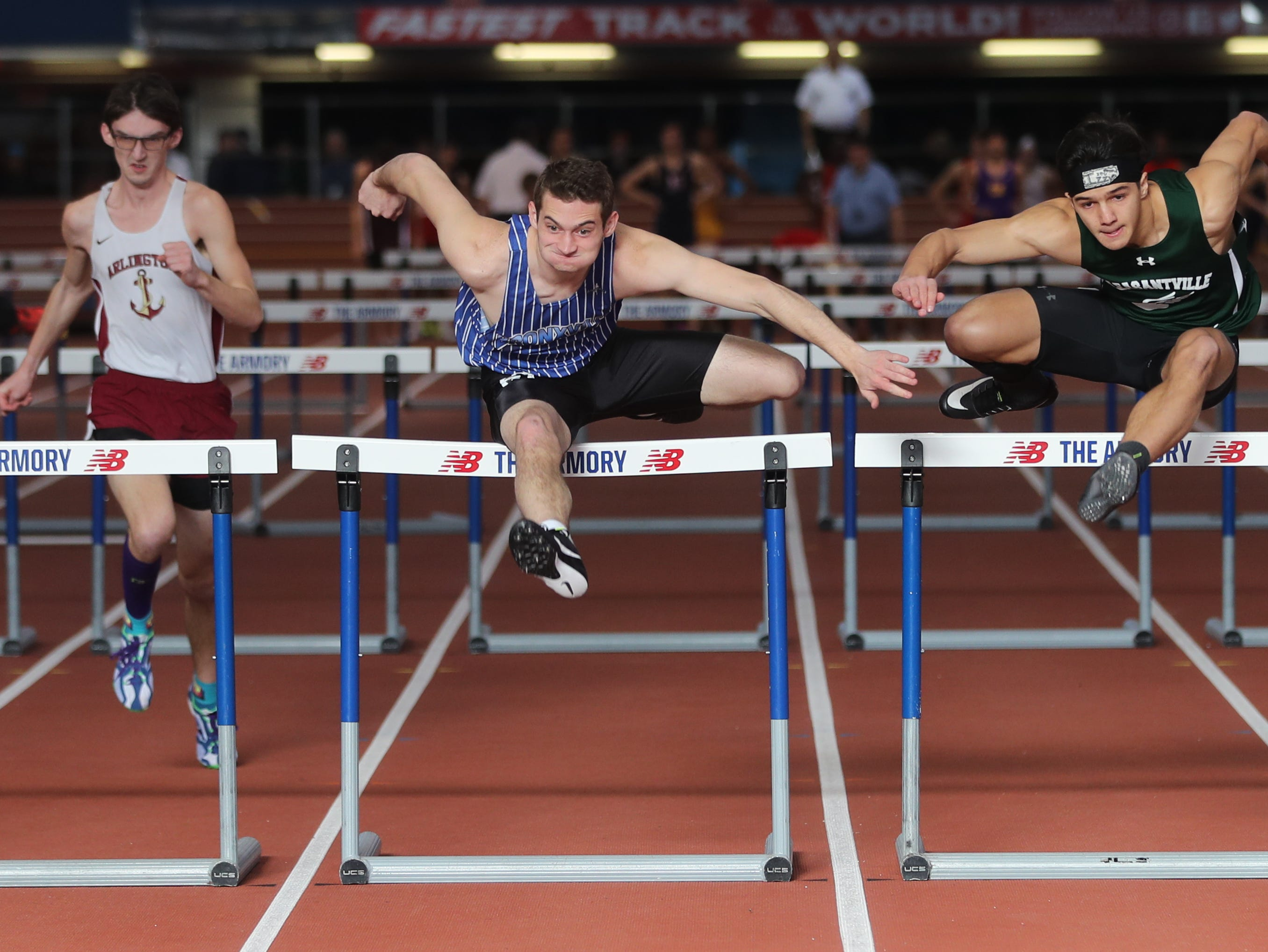 Seamus Watters of Bronxville and Adrian Rippstein of Pleasantville tied for first place in their heat of the 55 meter hurdles during the Section 1 New York State Track and Field State Qualifier at the New Balance Armory in Manhattan Feb. 17, 2019.