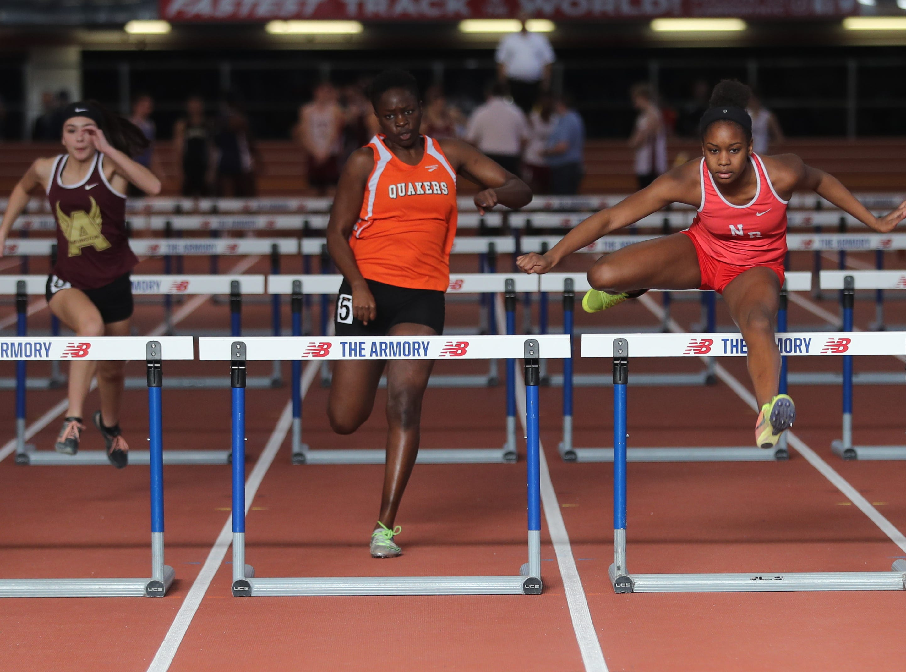 Nadia Saunders, right, of North Rockland won her heat in the 55 meter hurdles during the Section 1 New York State Track and Field State Qualifier at the New Balance Armory in Manhattan Feb. 17, 2019.