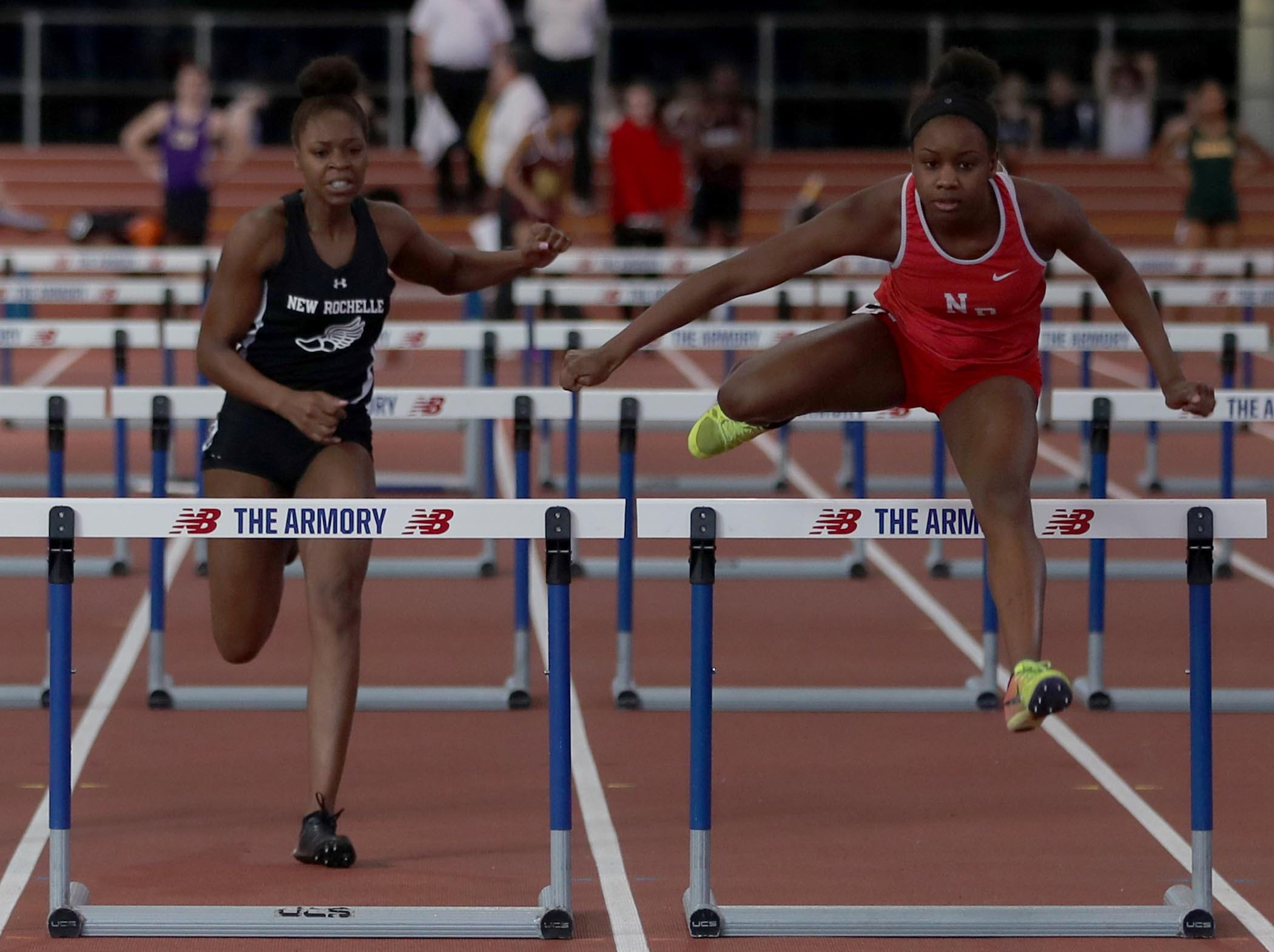 Nadia Saunders, right, of North Rockland won the 55 meter hurdles during the Section 1 New York State Track and Field State Qualifier at the New Balance Armory in Manhattan Feb. 17, 2019. Saunders won with a time of 7:36.