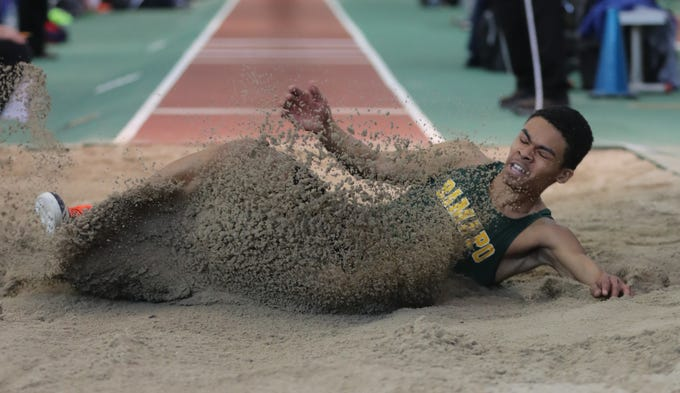Christopher Fils of Ramapo competes in the long jump during the Section 1 New York State Track and Field State Qualifier at the New Balance Armory in Manhattan Feb. 17, 2019.