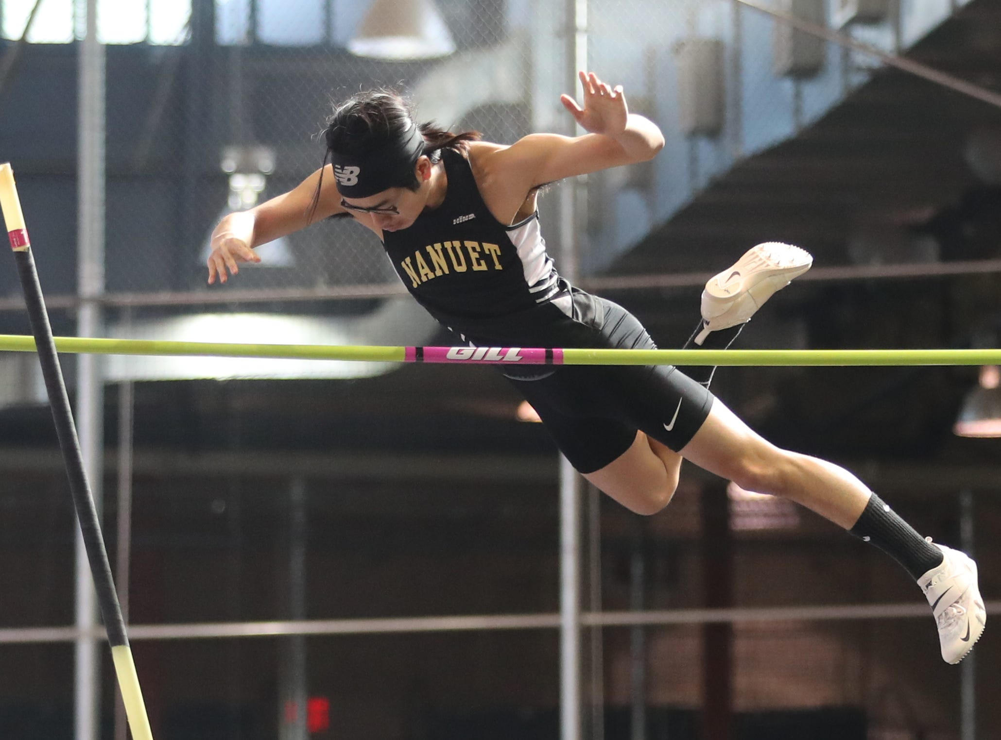 Athletes compete in the Section 1 New York State Track and Field State Qualifier at the New Balance Armory in Manhattan Feb. 17, 2019.