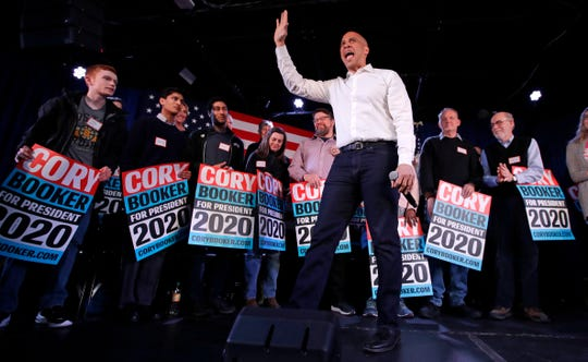 U.S. Sen. Cory Booker, D-N.J., waves to the crowd during a campaign stop in Portsmouth, N.H., Saturday, Feb. 16, 2019.