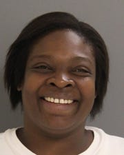 Kelli Collins, 43, of Newark, has been charged with first-degree robbery, resisting arrest, possession ofa controlled or counterfeit substance, possession of drug paraphernalia and menacing.