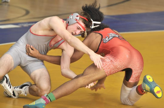 Smyrna's Nick Natorcola trying to escape from Isaiah Jenkins in the 138-pound match. Natorcola won by decision 11-6.