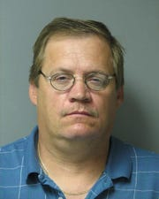 William R. Parlier, 53, of Seaford, has been charged with committing a crime against a vulnerable adult, two counts of home improvement fraud by false pretense, two counts of theft by false pretense, two counts of engaging in contract business without a license and two counts of carrying on an occupation without a license.