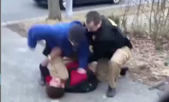 A screenshot from a video showing a New Castle County Police Officer punching a 16-year-old in the face during an arrest on Feb. 15.