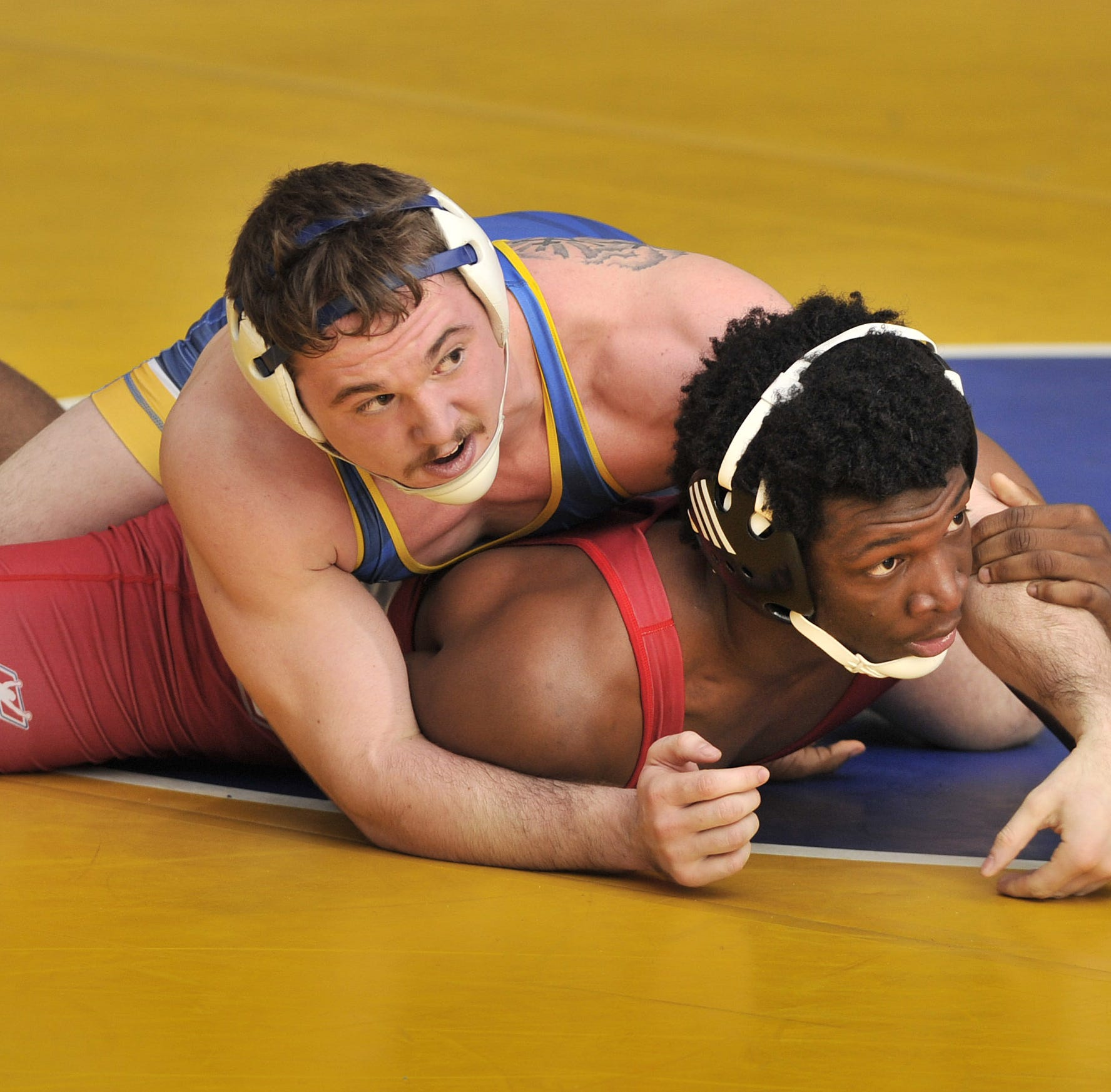 Crowd lifts Sussex Central's Wright to Henlopen wrestling title on home mat