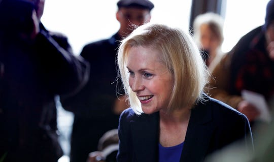 Sen. Kirsten Gillibrand, D-NY, smiles as she listens to a patron while visiting a coffee shop on Main Street in Concord, N.H., Friday, Feb. 15, 2019. Gillibrand visited New Hampshire as she explores a 2020 run for president.