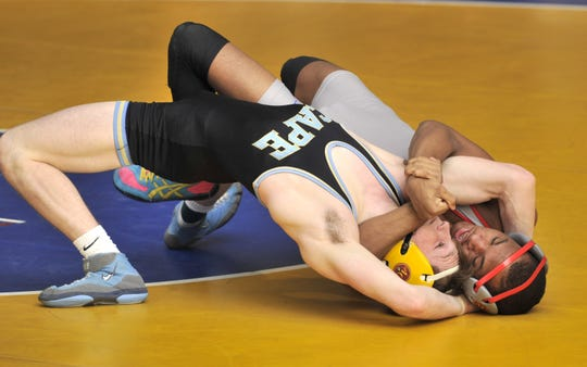 In the 132-pound bout Smyrna's Amir Pierce trying for back points against Cape's Anthony Caruso. Caruso won by decision 17-11.