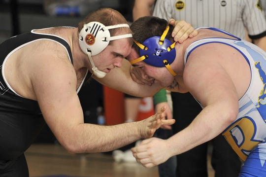 Kevin Hudson of Caesar Rodney won by fall in the last few seconds of the 3rd period over Jamie Schirmer of Sussex Tech in heavyweight match.