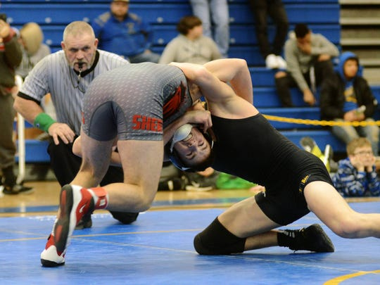 Sheridan's Nick Ranalli tries to fight out of a headlock from Karter Jones, of Tri-Valley, at 138 pounds during the Muskingum Valley League Tournament on Saturday at West Muskingum's Gary Ankrum Gymnasium. Ranalli won, 8-6, to help Sheridan win the league title.