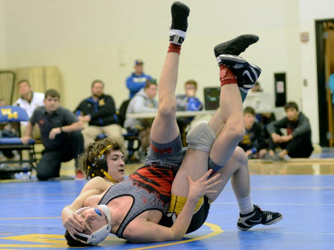 Tri-Valley's Sky Wisecarver and Sheridan's Alexander Crane, left, wrestle during the MVL meet. Wisecarver was voted the TR Male Athlete of the Week.