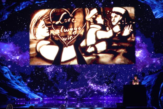 Sand artist Kseniya Simonova, lower right, was a favorite of host Terry Crews, receiving his golden buzzer in NBC's 'America's Got Talent: The Champions.'