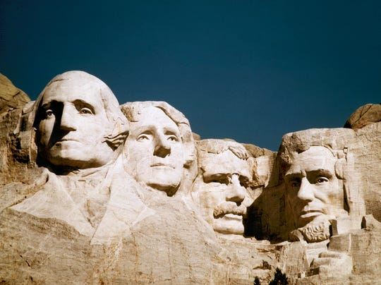 George Washington and Abraham Lincoln flank Thomas Jefferson and Teddy Roosevelt at Mount Rushmore in South Dakota.
