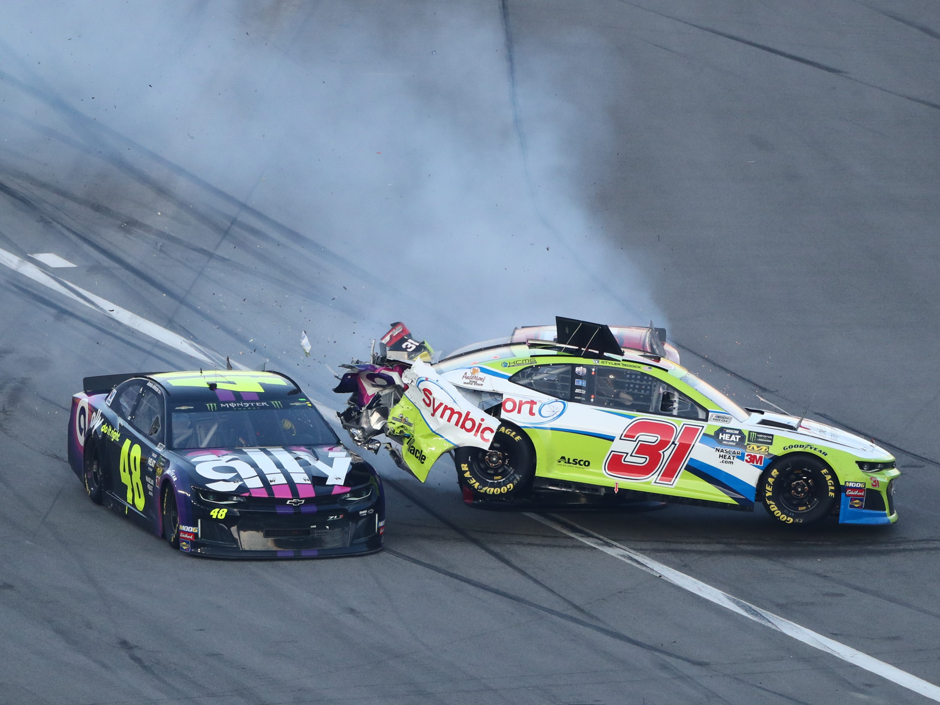 NASCAR Cup Series driver Tyler Reddick (31) collides with Jimmie Johnson (48) entering pit road during the Daytona 500 at Daytona International Speedway.