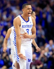 Kentucky guard Keldon Johnson celebrates a three-pointer in the Wildcats' convincing win over No. 1 Tennessee.
