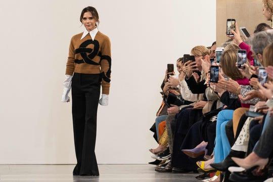 British designer Victoria Beckham acknowledges the crowd during her 2019 Autumn / Winter collection catwalk show.
