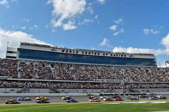Hendrick Motorsports drivers William Bryon (24) and Alex Bowman (88) lead the field as the green flag waves to start the 2019 Daytona 500.