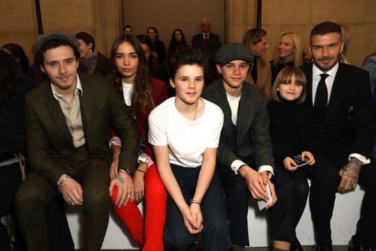 (L-R) Brooklyn Beckham, Hana Cross, Cruz Beckham, Romeo Beckham, Harper Beckham and David Beckham attends the Victoria Beckham show during London Fashion Week on February 17, 2019.