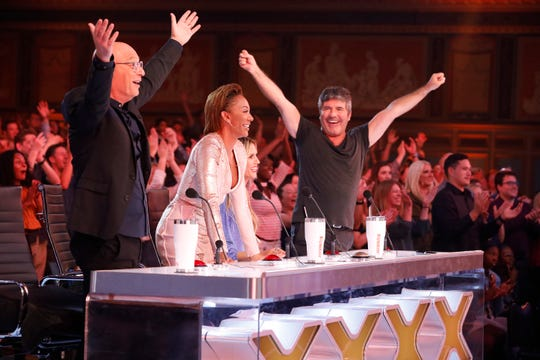 'America's Got Talent' judges Howie Mandel, left, Mel B, Heidi Klum and Simon Cowell cheer an act during 'Champions,' a special winter edition featuring 50 'Got Talent' winners and standout performers.
