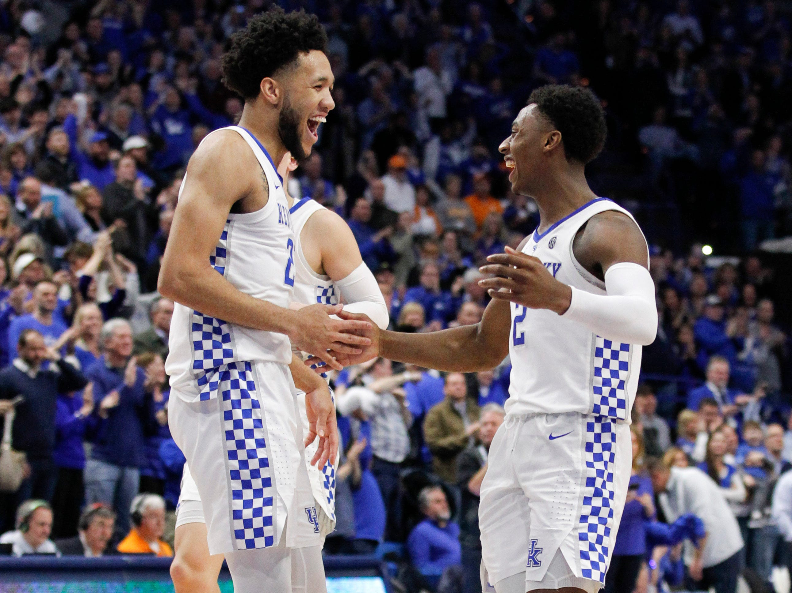 Ashton Hagans (2) and E.J. Montgomery (23) celebrate a big second-half bucket.