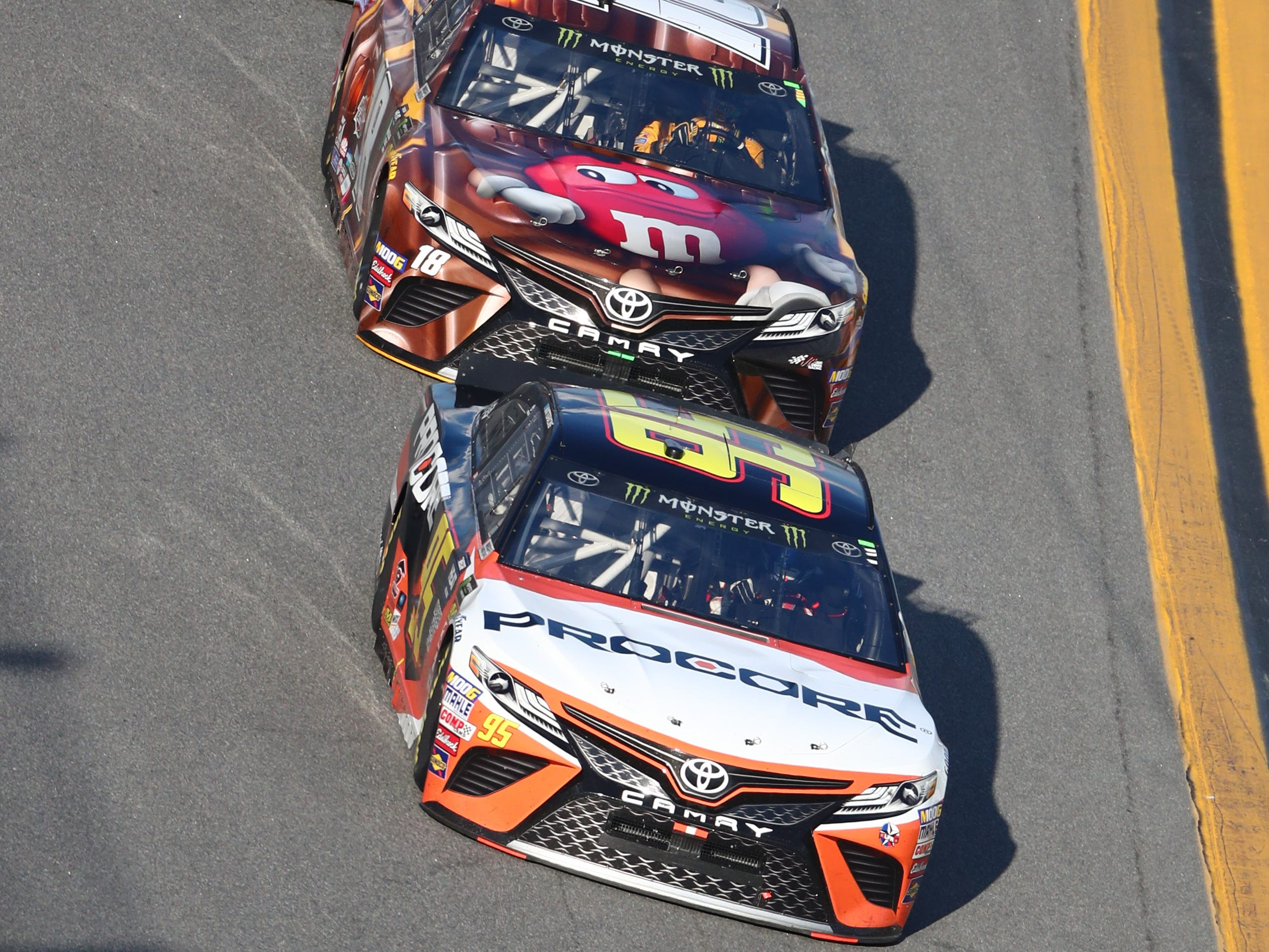 NASCAR Cup Series driver Matt Dibenedetto (95) leads Kyle Busch (18) and Alex Bowman (88) during the Daytona 500 at Daytona International Speedway.