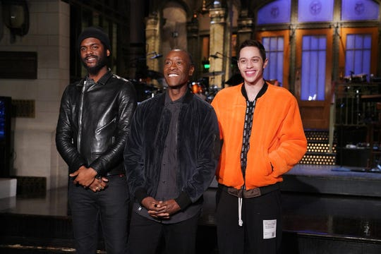 Don Cheadle with Gary Clark Jr. left and Pete Davidson host
