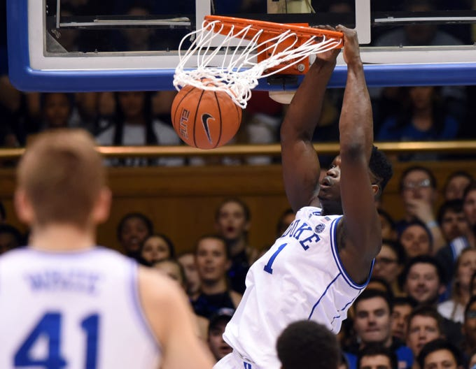 Zion Williamson dunks during the first half against the North Carolina State Wolfpack at Cameron Indoor Stadium on Feb. 16.