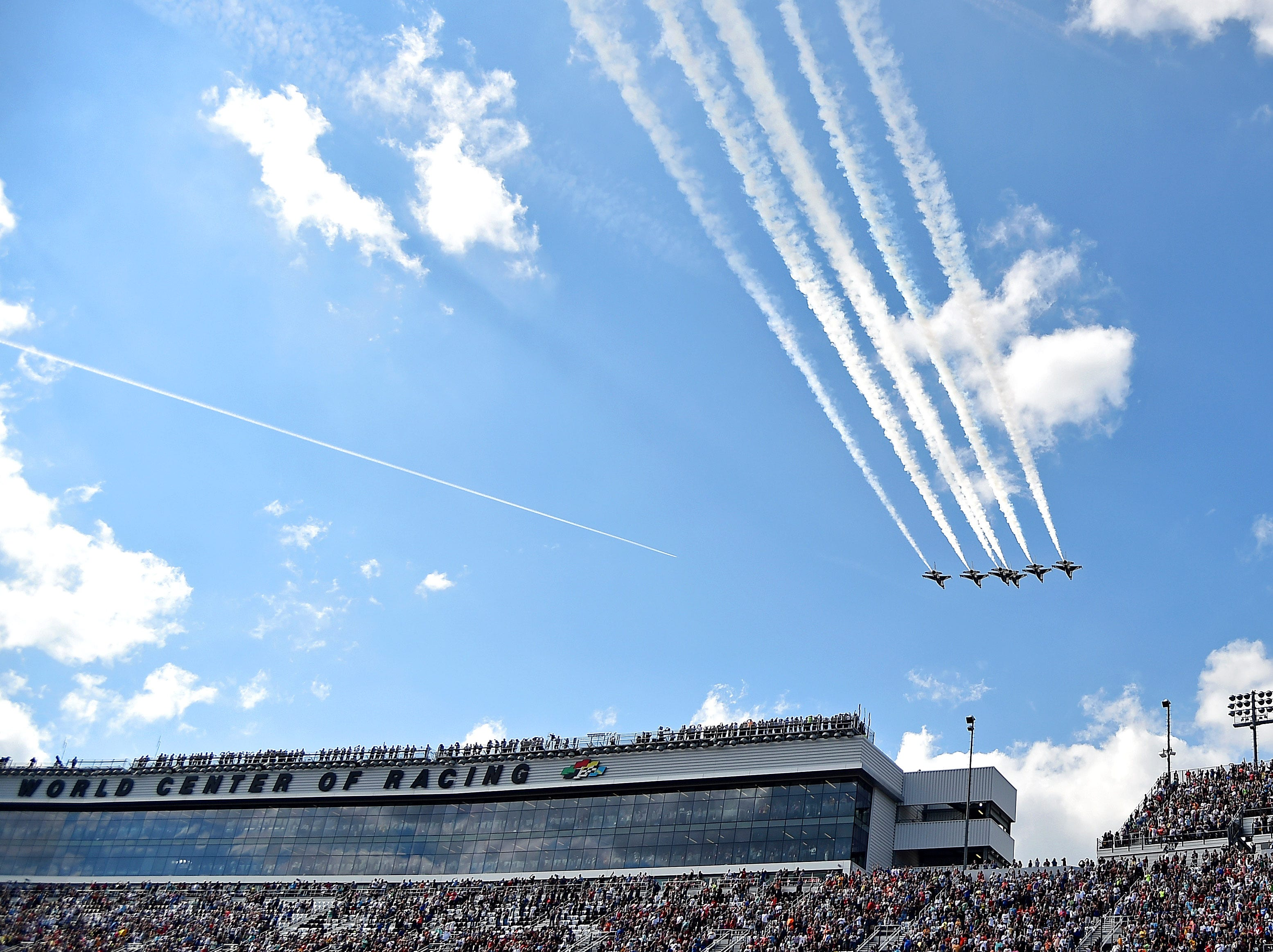 The U.S. Air Force Thunder Birds perform a flyover before the 2019 Daytona 500 at Daytona International Speedway.