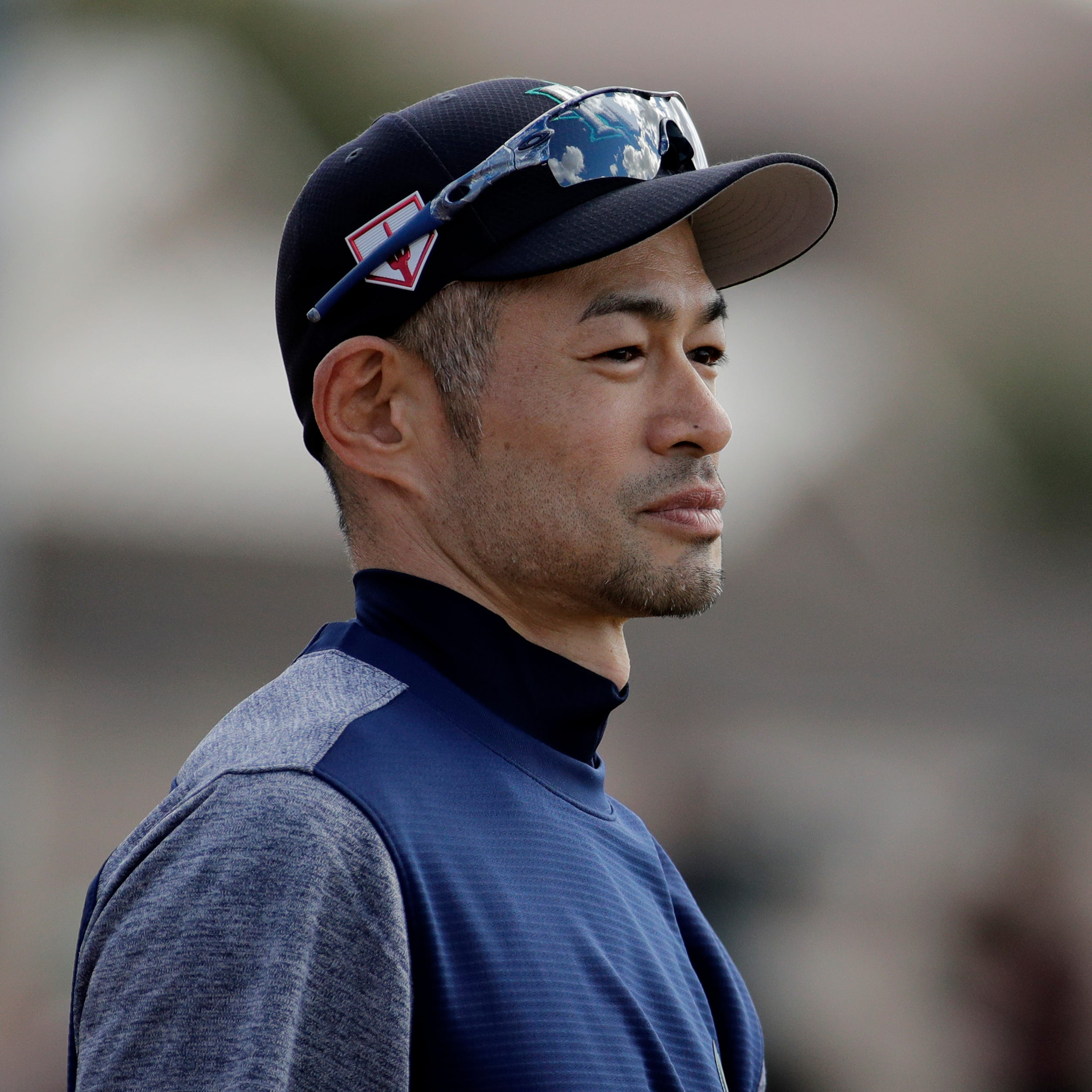 Ichiro Suzuki waits to take batting practice on...
