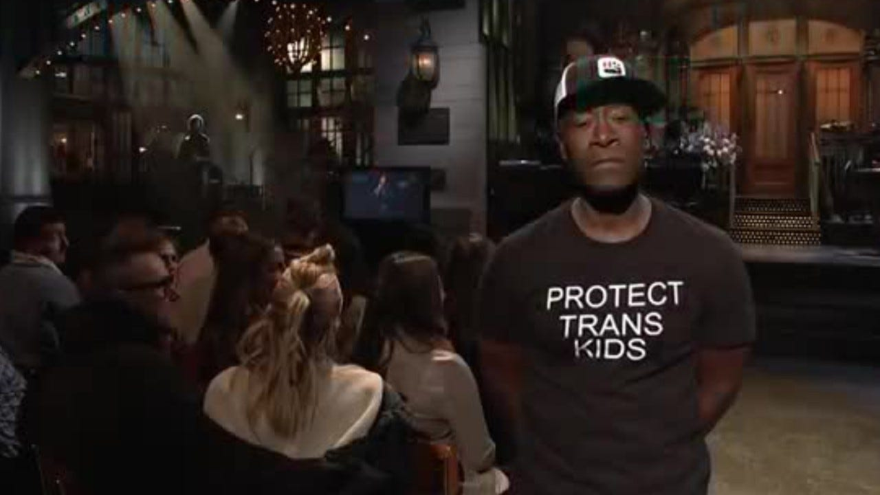c1528536c 'SNL' host Don Cheadle makes fashion statement, dons Trump Soviet Union  jersey