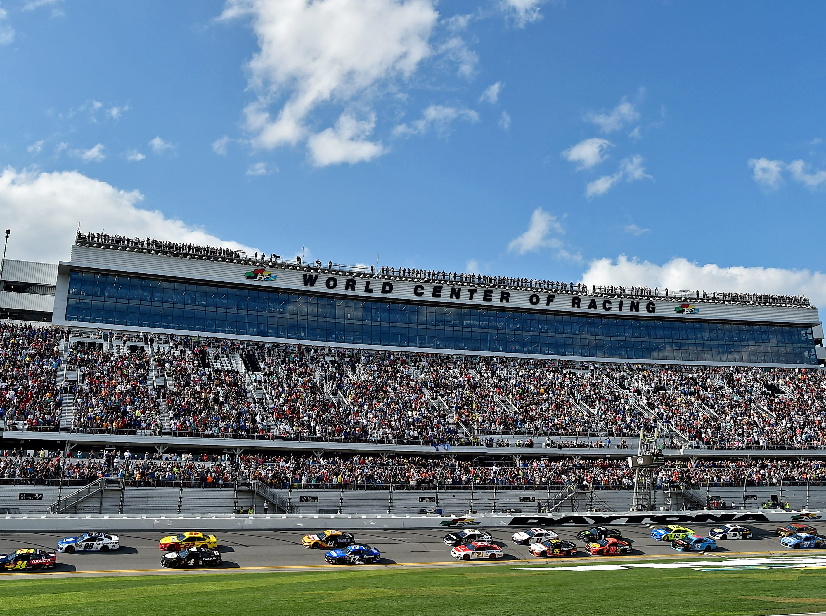 Hendrick Motorsports drivers William Bryon (24) and Alex Bowman (88) lead the field to the start of the 61st annual Daytona 500 at Daytona International Speedway.